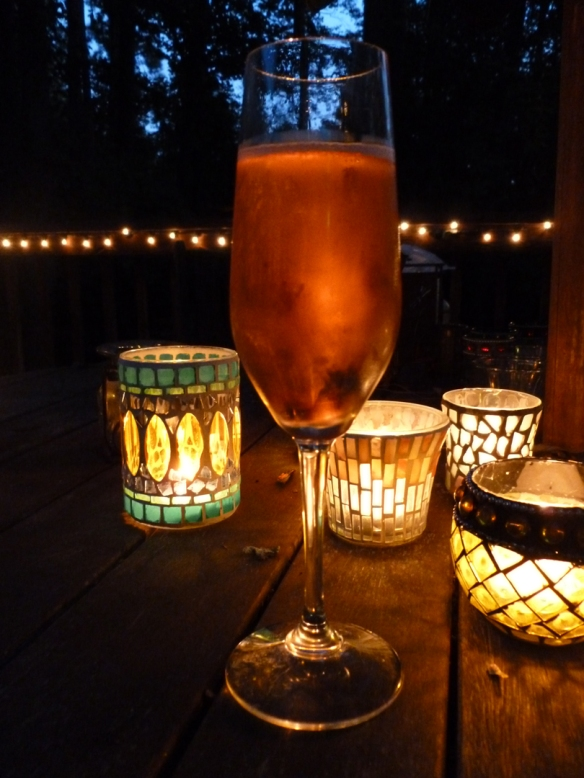 The color change of the layers in the Kir Royale are so subtle, they are hard to photograph, but you can see whatever it is, it's a pretty color in candlelight!