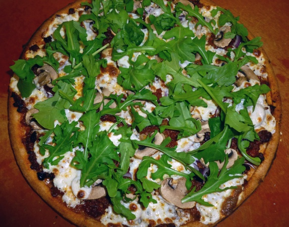 If you like, you can add a sprinkle of fresh arugula leaves to the finished pizza for a little peppery bite!