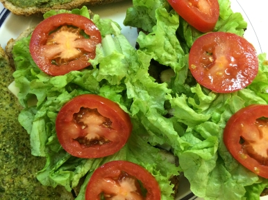 Then crisp local lettuce and some roma tomato...