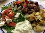 Souvlaki from the grill with peppers and onions, roasted potatoes, Greek salad and tzatziki.