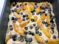 Top with half of the fruit mixture tossed in flour.