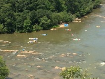 "People on rafts ""shooting the hootch"" rapids."