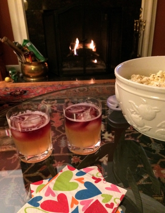 "First course was the ""Rouge"" cocktail paired with Truffled Popcorn with Pecorino."