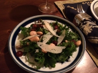 A salad of roasted and raw grapes, arugula, almonds and manchego with Saba vinaigrette.