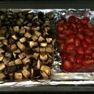 "Mushrooms and tomatoes in their foil ""tray"" ready for roasting."